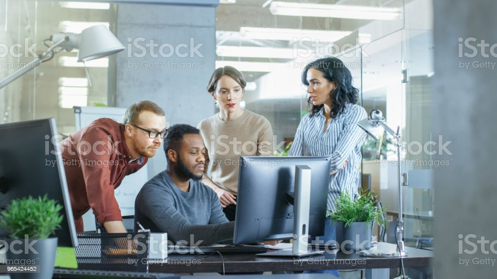 In Busy Corporate Office Team of Diverse Young Creative People Work on a Problem Solution. Collectively They Try to Help Coworker to Solve Problem. royalty-free stock photo