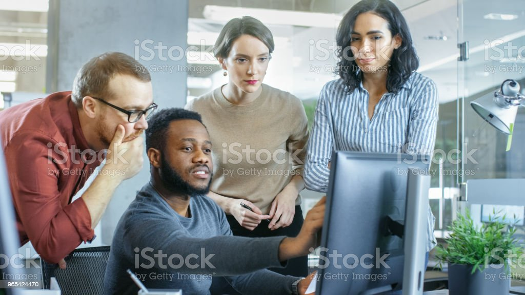 In Busy Corporate Office Team of Diverse Young Creative People Work on a Problem Solution. Collectively They Try to Help Coworker to Solve Problem. zbiór zdjęć royalty-free