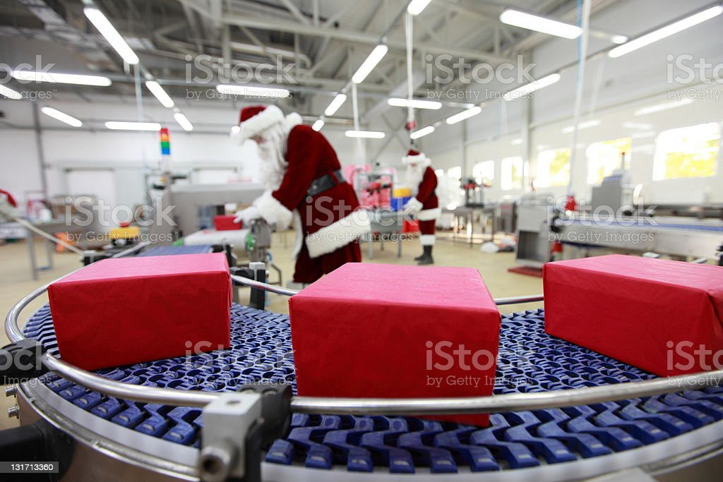 In Christmas presents factory royalty-free stock photo