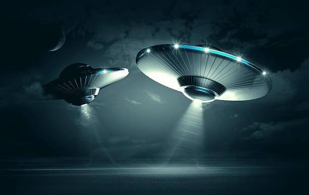 UFO in dark night stock photo