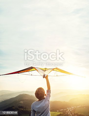 istock In dreams about flying. Boy takes a kite over his head 1018926144