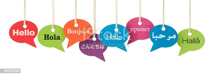 Speech bubbles contain the word HELLO in eight different languages. English, Spanish, French, Japanese, German, Russian, Arabic and Swedish. International business, translation services etc. Isolated on a pure white background, absolutely no dot in the white area – no need to cut-out.