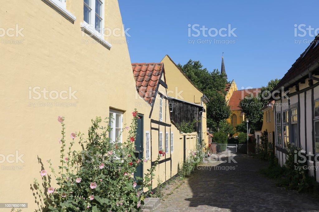 In end of street Helligåndskirken Church, Faaborg Denmark stock photo