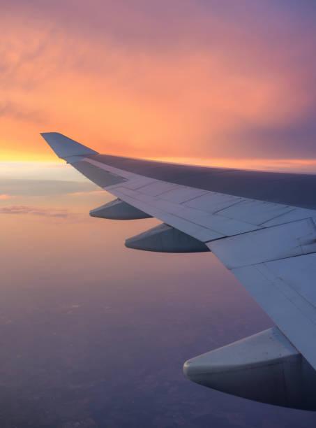 In Flight At Sunrise Or Sunset stock photo