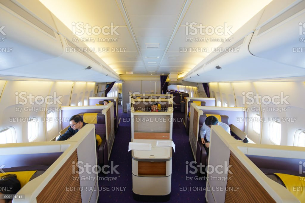 In flight of Thai Airways Boeing 747-400 in first class(vr.74N) cabin with passengers on board at Suvarnabhumi Airport stock photo