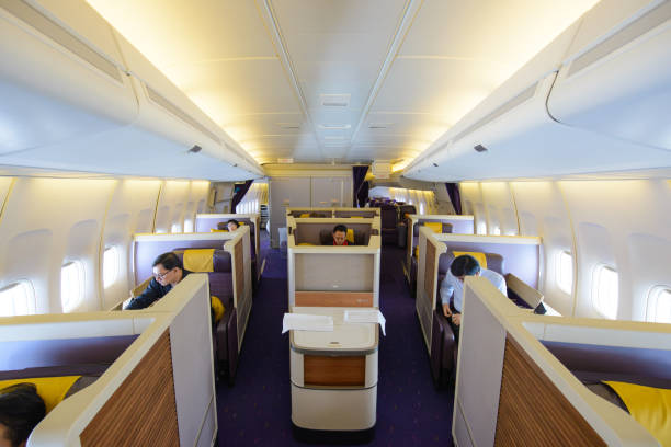 in flight of thai airways boeing 747-400 in first class(vr.74n) cabin with passengers on board at suvarnabhumi airport - respiratory tract stock photos and pictures