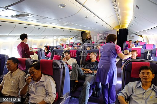 istock In flight service of Thai Airways Boeing 777-300 in business class(Royal silk class) cabin with passengers on board from Suvarnabhumi Airport - Phuket Airport 909441216