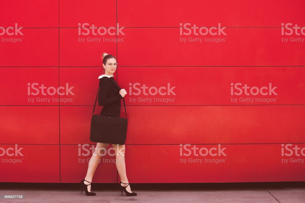 in front of red wall stock photo