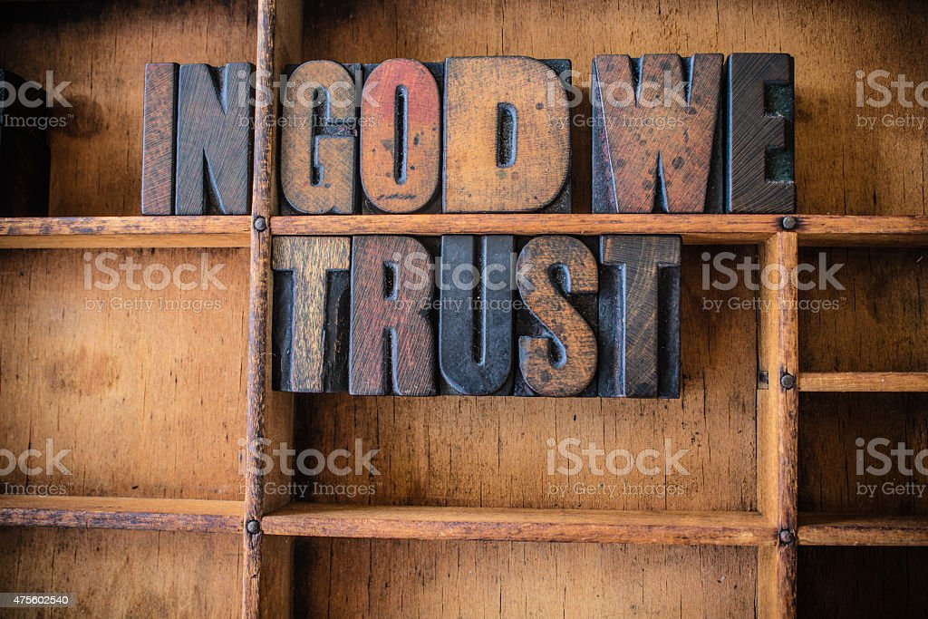 In God We Trust Concept Wooden Letterpress Theme stock photo
