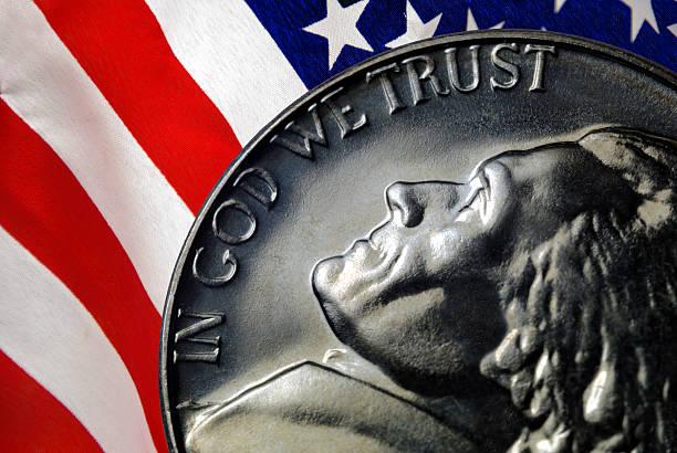 In God We Trust, US Nickel, American Flag stock photo