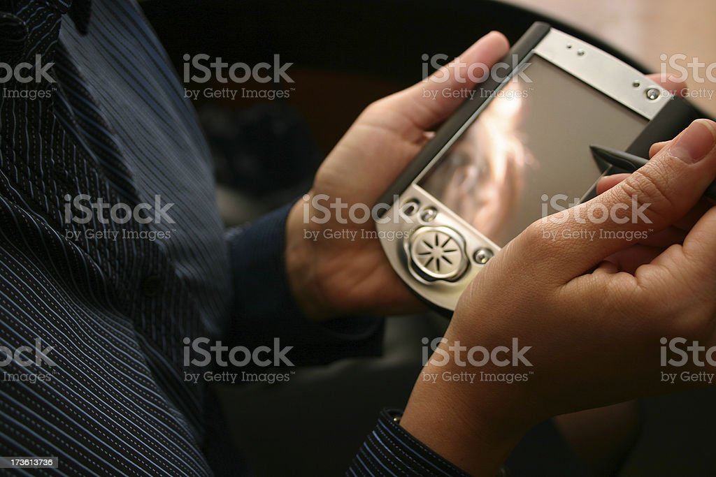 PDA in hand royalty-free stock photo
