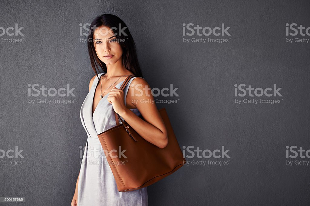 In her bag she carries the world stock photo