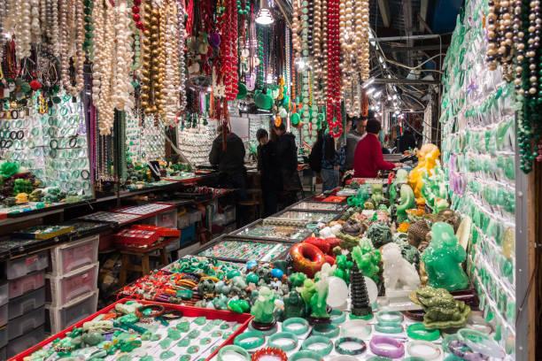 In Hong Kong Jade Market there are many stands selling all kinds of jade, pearls, semi-precious stones, Hong Kong, Kowloon stock photo