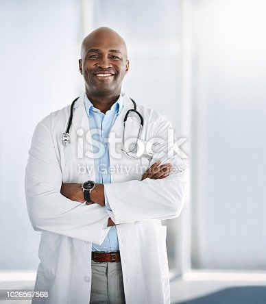 Shot of a confident young doctor working in a hospital