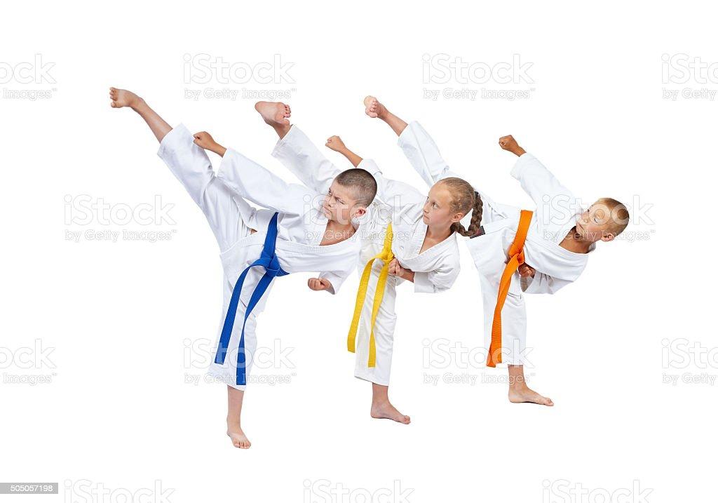 In karategi three athletes beats kick leg