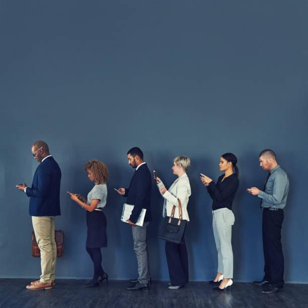 in line for opportunity - queue foto e immagini stock