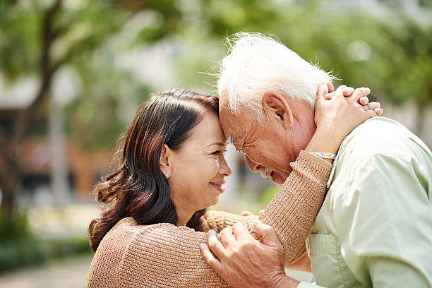 In love and happy Happy senior people smiling when looking at each other vietnamese ethnicity stock pictures, royalty-free photos & images