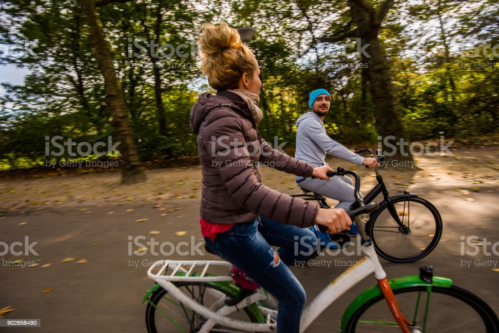 In Love Couple Riding Bikes In Nature At Sunny Day Stock Photo