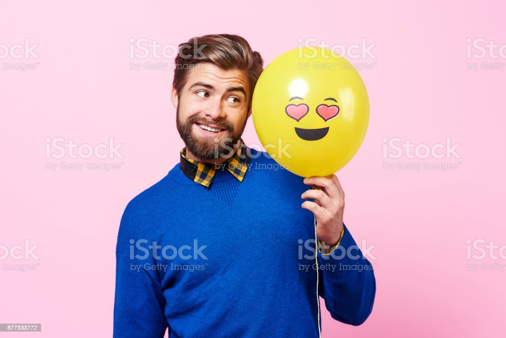 In love eccentric with balloon dreaming stock photo