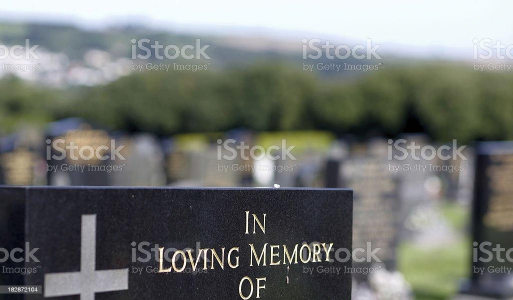 In loving memory gravestone inscription closeup stock photo