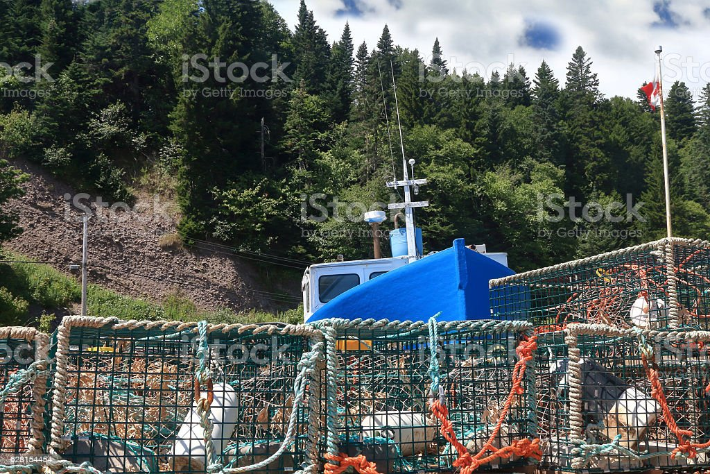 In marina of St. Martins Fishing boat and lobster traps stock photo