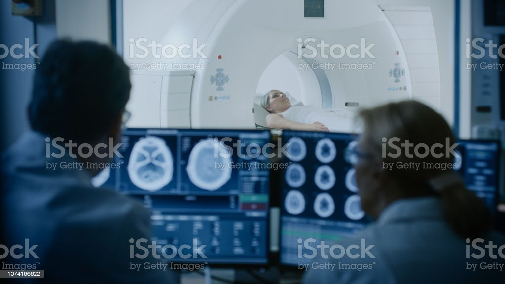 In Medical Laboratory Patient Undergoes MRI or CT Scan Process under...
