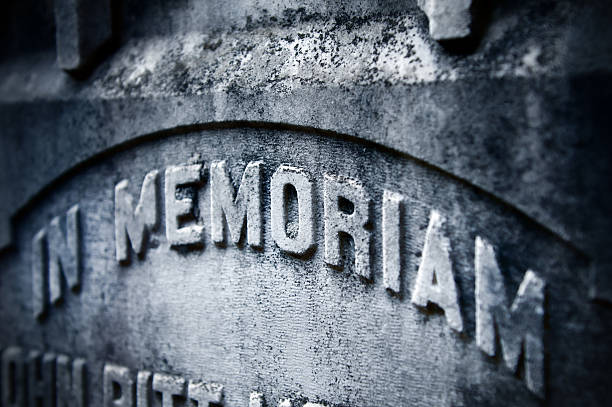 in memoriam - engravement on tombstone - engravement stock photos and pictures