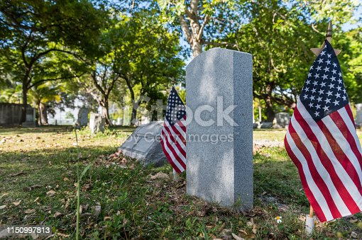 Simple tribute to the fallen heroes in a cemetery.