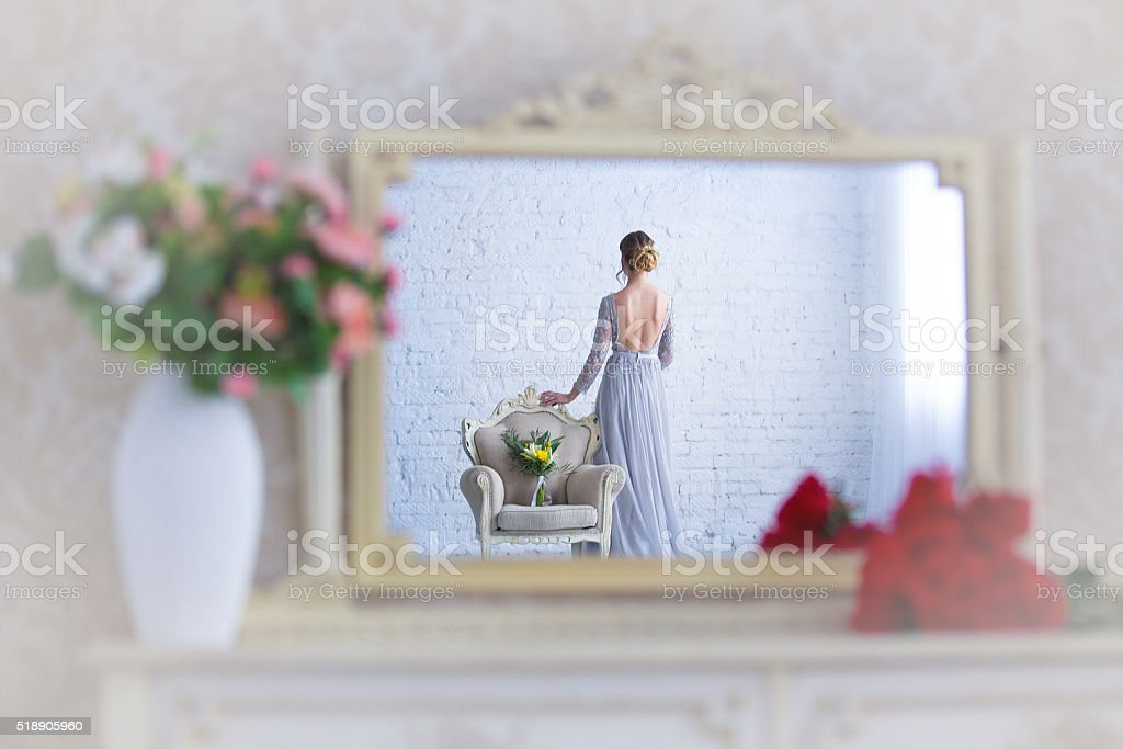 in  mirror on shelf reflected chair with and bride stock photo