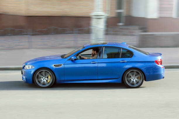 BMW M5 (F10) in motion at high speed stock photo