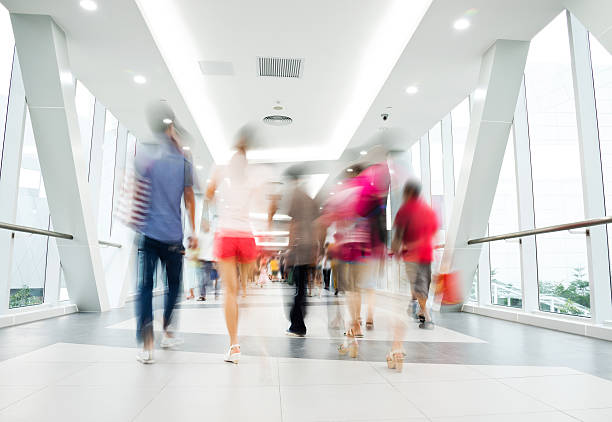 In motion picture of people walking down hallway  stock photo