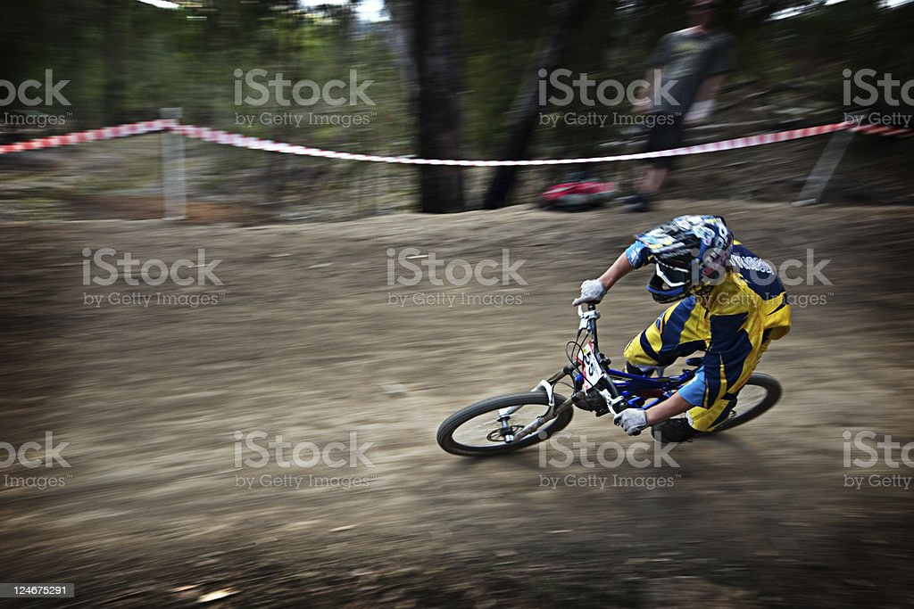 In motion shot of a person down hill mountain biking royalty-free stock photo