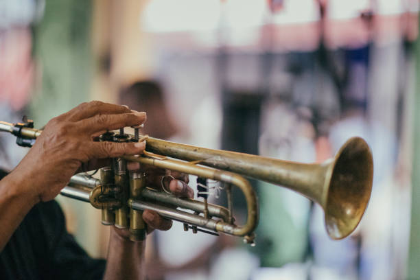 In Old Havana, close-up of a Cuban musician hands while he is playing his trumpet. stock photo
