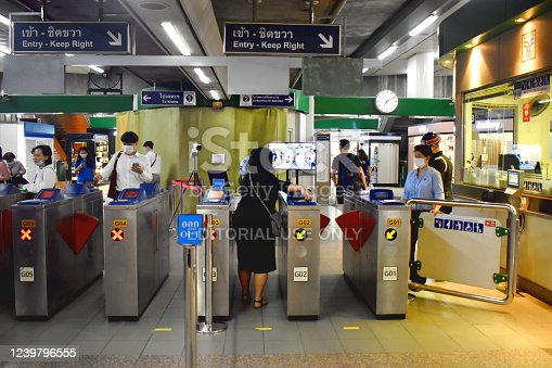Bangkok Thailand - June 1, 2020 : In outbreak of COVID-19  BTS skytrain station using technology face recognition in checkpoint before entrance system. This technology is against and harmful to people privacy and  humankind.