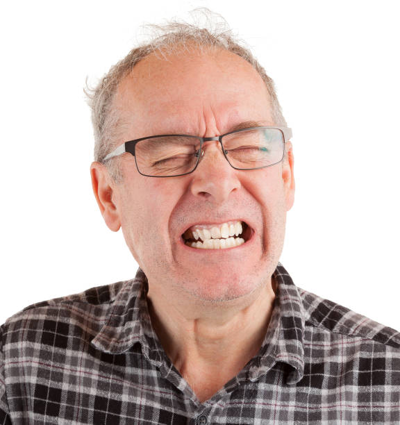 Schmerzverzerrtes Gesicht