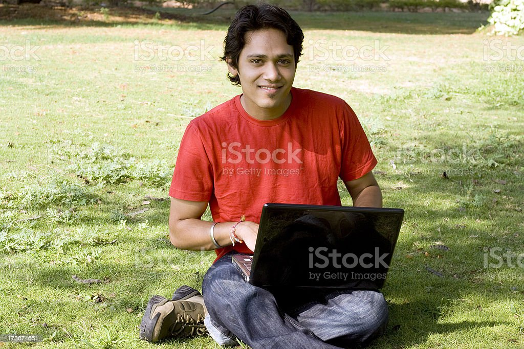 In park with laptop royalty-free stock photo