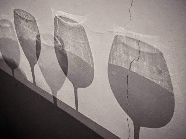 In Puerto Plata, shadow of different types of wine glasses on a wall. stock photo