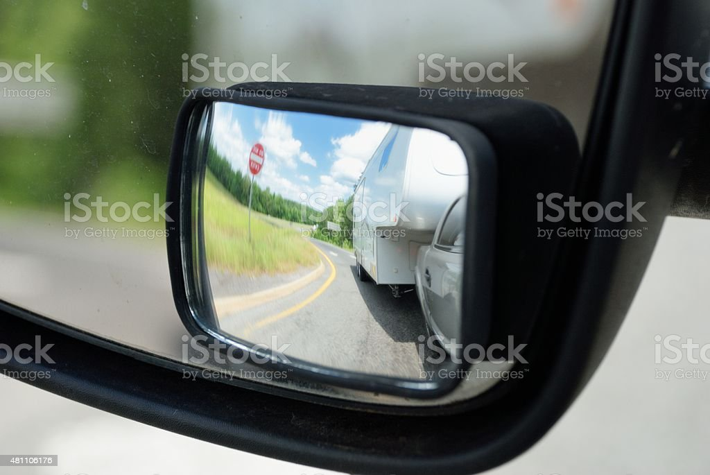 RV in rear view mirror stock photo