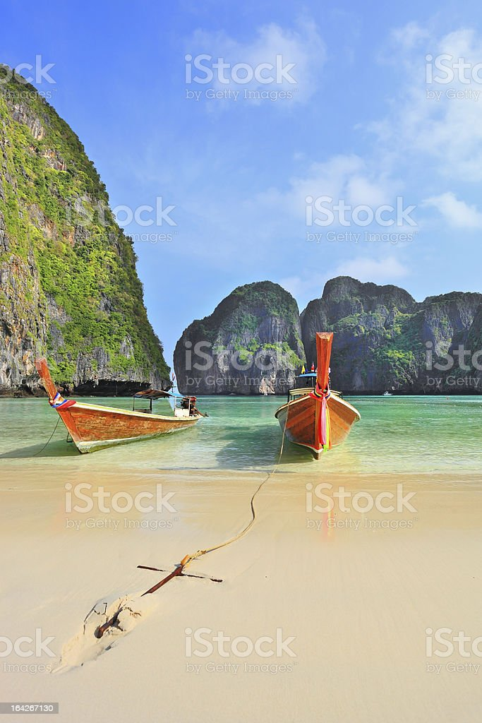 In sand approached by two tourist boats royalty-free stock photo