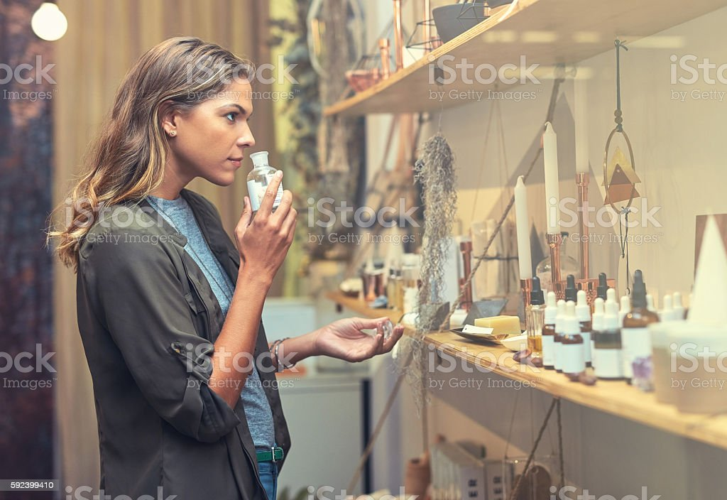 In search of the perfect scent Shot of a young woman checking the merchandise in her store 20-29 Years Stock Photo