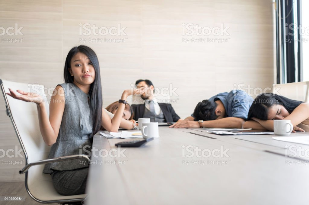 In selective focus of Business people are sleeping in the conference room during a meeting. stock photo