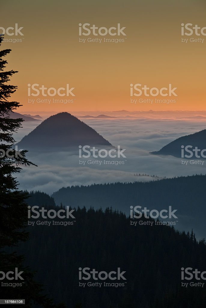 Foggy Peaks at Sunset stock photo