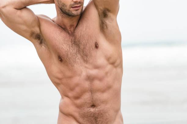 in Form unkenntlich muskulöser Mann am Fistral Beach, Newquay, Cornwall – Foto