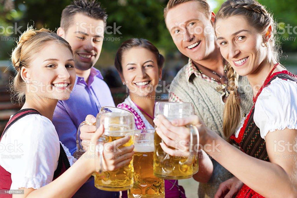 In summer garden - friends drinking beer stock photo