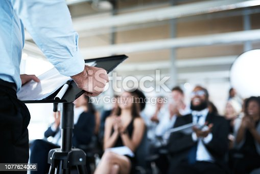 Shot of a businessman giving a presentation at a conference