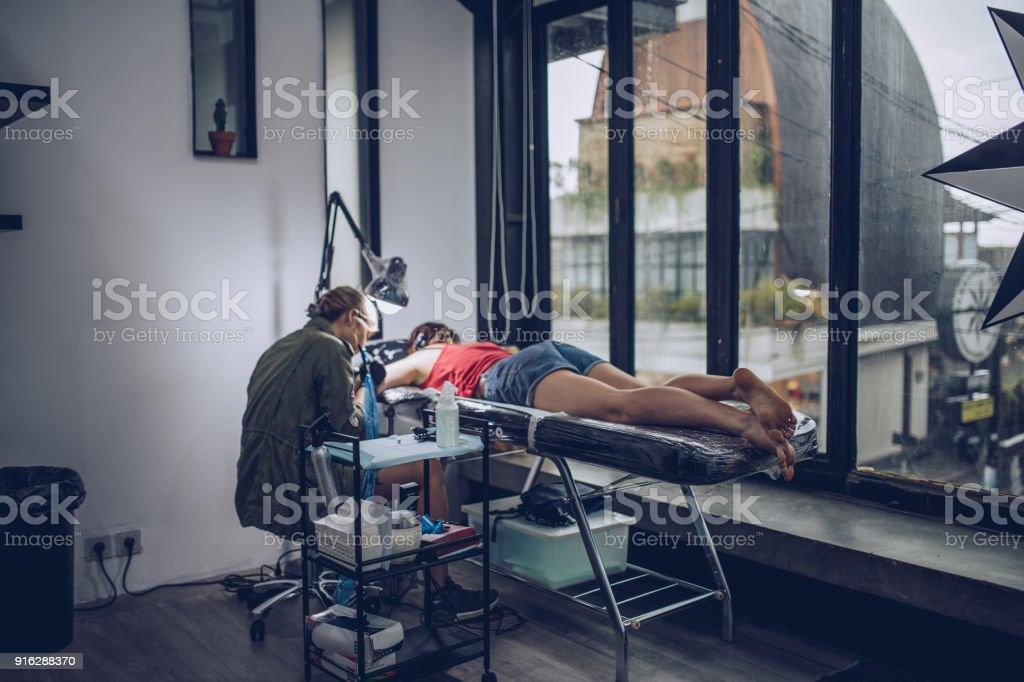 In tattoo studio stock photo