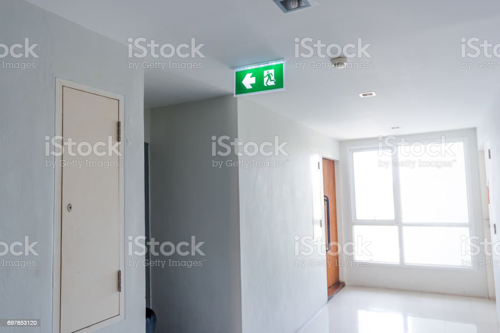 In terms of fire safety, the final exits on an escape route in a public building are known as fire exits. stock photo
