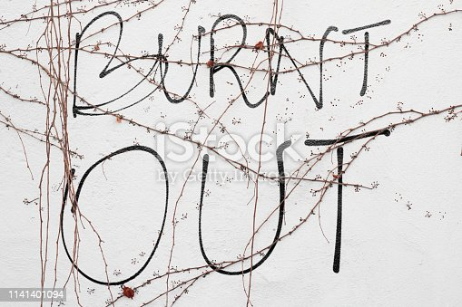 istock BURN OUT in text on a wall 1141401094