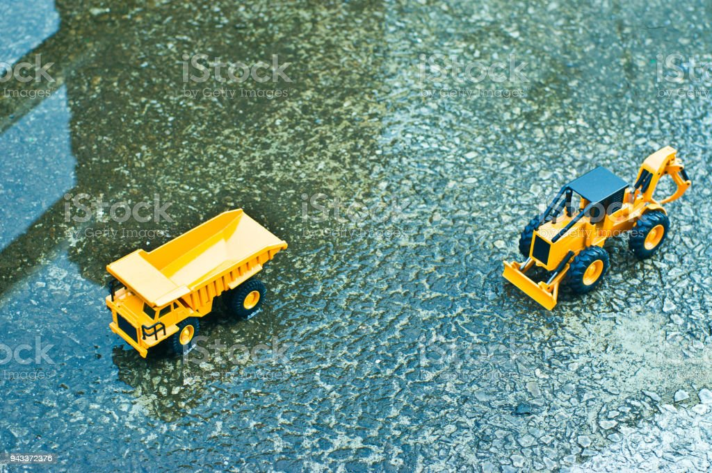 In the afternoon, after the rain stops, trucks and folklans are working on to prevent disaster. stock photo