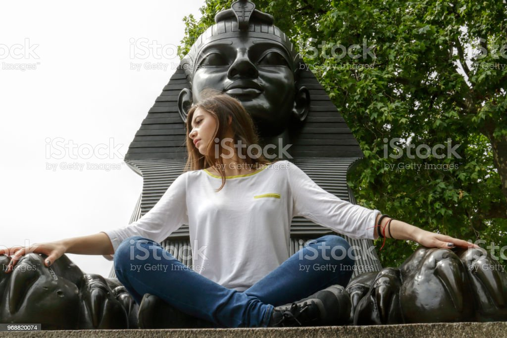 In the arms of the Sphinx Bulgarian outdoor girl stock photo